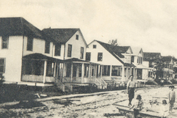 old photograph of homes along a street
